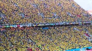 Brazilian supporters sing the national anthem