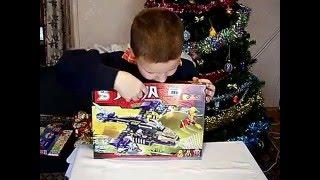 Моё первое видео. Новогодние подарки от Деда мороза ЛЕГО NINJA. Барни(Я выложил своё первое видео. Новогодние подарки от Деда мороза, которые я нашёл под ёлкой - ЛЕГО NINJA. Самый..., 2016-01-01T20:04:05.000Z)