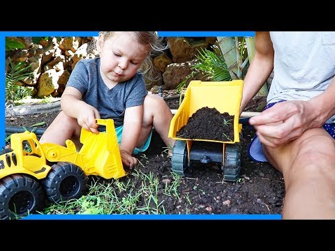 OPENING SURPRISE TOY CONSTRUCTION TRUCKS AND DIGGING IN THE DIRT
