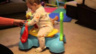 baby playing with fisher price 3 in 1 bounce stride and ride elephant