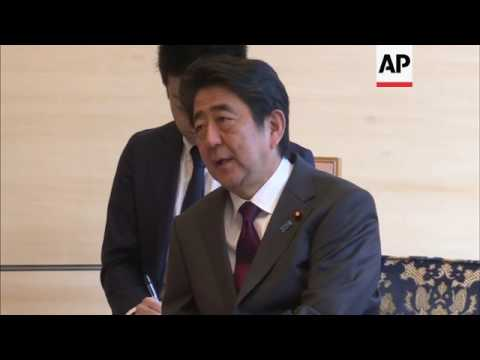 Top China official welcomed by Japan PM in Tokyo