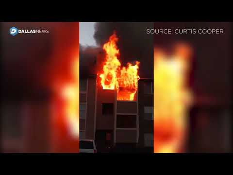 Bystander catches baby dropped from window as fire consumes Far East Dallas apartment building