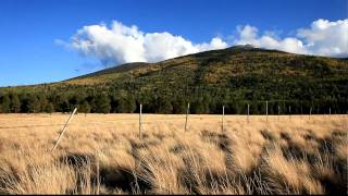 HD Autumn Scene - Clouds Passing Over a Golden Mountain