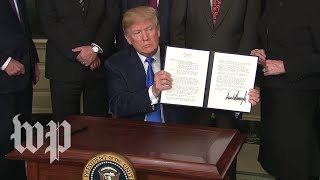 Trump signs measure hitting China with $50 billion in annual tariffs