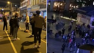 video: Watch: Crowds gather in London high streets after 10pm curfew