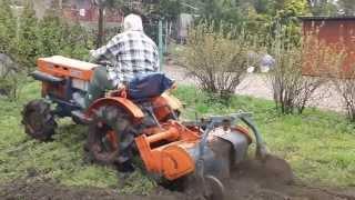 Ciągniczek japoński z glebogryzarką. Sprzedaż japońskich traktorków. www.traktoreki.waw.pl
