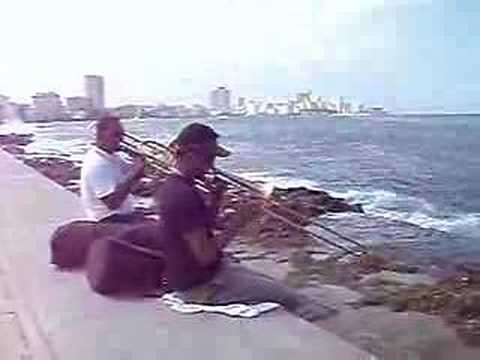 Tombonists practicing on waterfront