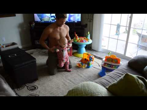 Baby takes 1st steps and father's reaction is priceless.