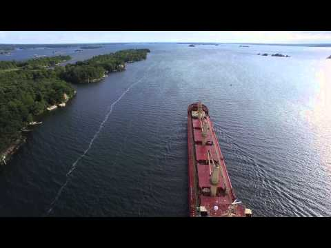 Aerial ship chasing on the St. Lawrence River - 4K UHD Video