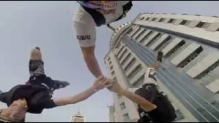 PRINCESS TOWER DUBAI BASEJUMPING HOLDING HANDS