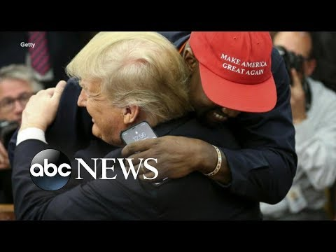 Kanye West hugs President Trump and ABC News Johnathan Karl in the Oval Office