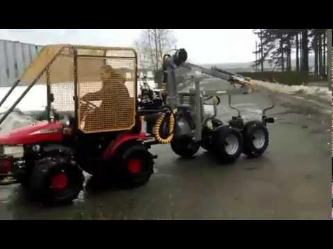 Мини-трактор Беларус - МТЗ с лесовозной тележкой.
