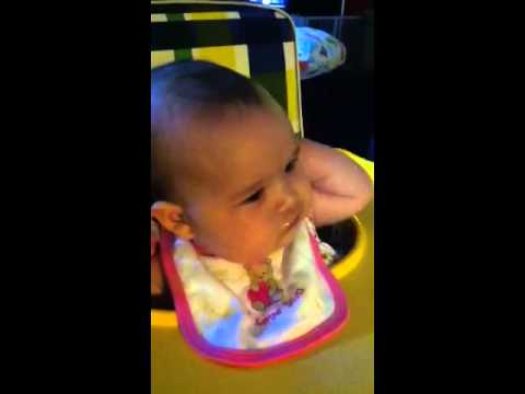 Eating in her vintage high chair