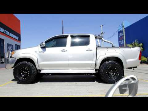 Toyota Hilux Custom Rims + Nitto Trail Grappler 285/75R16 Tires