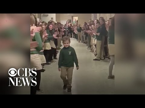 Boy who beat cancer gets surprise greeting from entire school