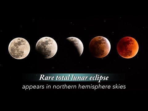 "Live: Rare total lunar eclipse appears in northern hemisphere skies ""超级月亮""巧遇""月全食"""