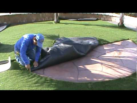 flagstone patio with grass. Cutting Artificial Synthetic Grass Around Flagstone Patio With