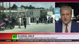 NGO founder surrenders to police, facing charges for helping refugees to enter Greece illegally