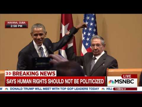 Raul Castro raises President Obama's limp arm