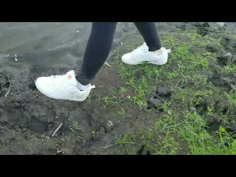 Girl new DC shoes trashing in thick deep mud