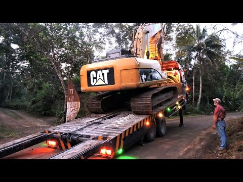 Self Loader Truck Moving Excavator CAT 320D Down The Hill