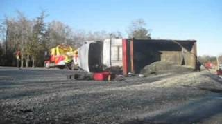 Dump truck full of gravel tips over on U.S. 80