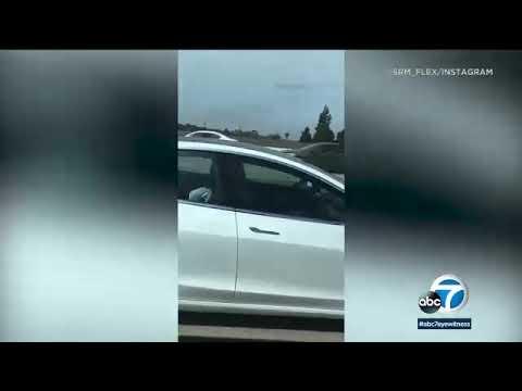 Kid Jay - Driver fast asleep while Tesla is on autopilot on freeway