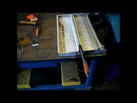 Cut and weld to shorten a metal shelf