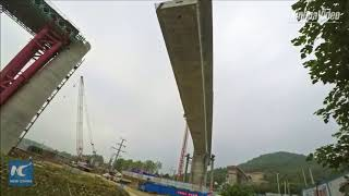 14,000 tons! High-speed rail bridge section swivels into position