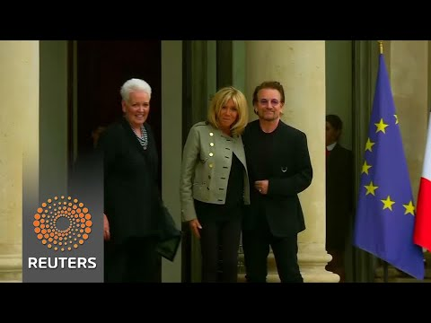 Pop singer Bono meets French president at Elysee Palace