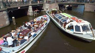 Chaos grachten Amsterdam: boem, bootje hozen, roer kapot, brug te laag en meerrr