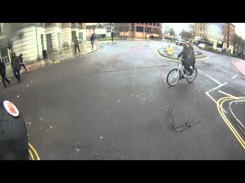 Cyclist on the phone, oblivious to traffic lights