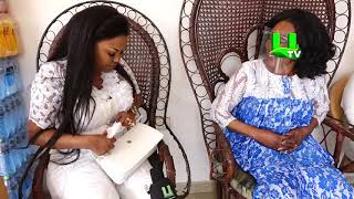 Grace Omaboe blesses Nana Ama Mcbrown as she donates cash, assorted items to the legendary actress