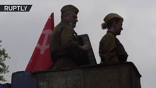 'Safe' celebration | Volunteers congratulate WWII veterans with war songs from a cherry picker
