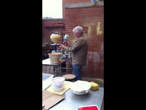 Steven Hill spraying glaze & talking process