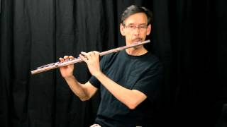 practicing single double and triple tonguing on the flute