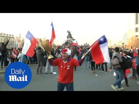 Chile fans jubilant after beating Portugal on penalties - Daily Mail