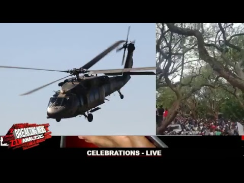 MUGABE'S HELICOPTER SEEN FLYING AWAY FROM STATE HOUSE
