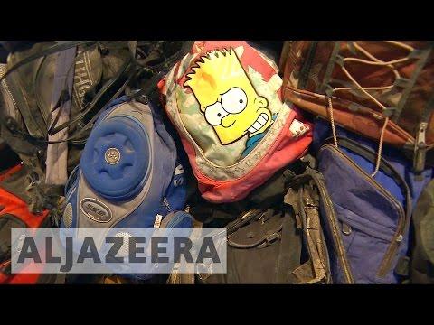 New York gallery puts refugee backpacks, belongings on display