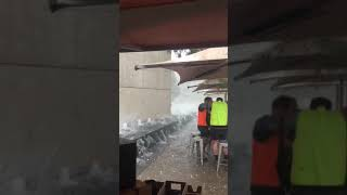 Workers Take Cover Under Umbrella as Hailstorm Smashes Canberra