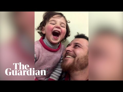 Syrian father teaches daughter to cope with bombs through laughter