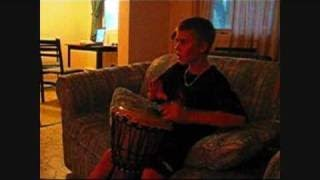 Justin Bieber playing the djembe