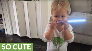 Little boy displays lightsaber skills like true Jedi