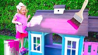 Stacy decora uma casa de brinquedos em rosa