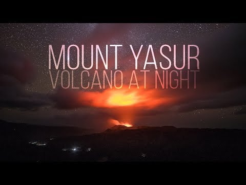Mount Yasur Volcano at night erupting