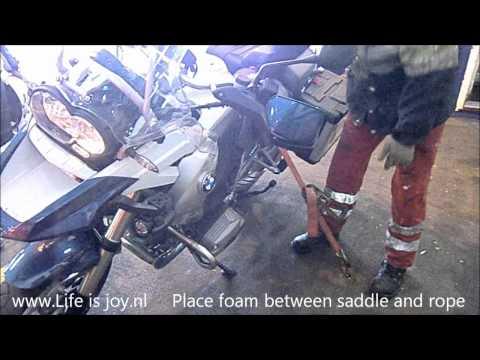 Motorbike, motorcycle loading on a ferry boat moto motor BMW R1200GS