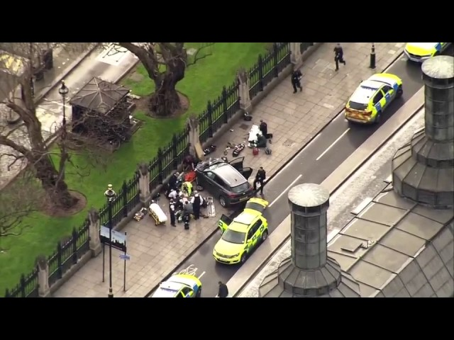 Police, paramedics surround car after attack outside UK parliament