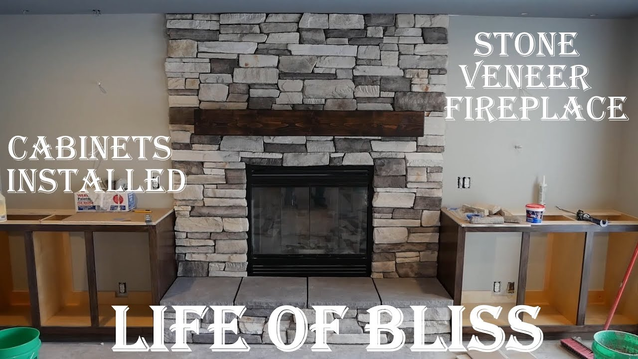 Installed Stacked Stone Fireplace Stained Built In Cabinets