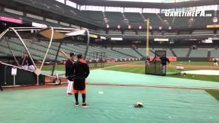 Ryan Flaherty and Caleb Joseph getting some batting practice in and Steve Pearce fielding grounders