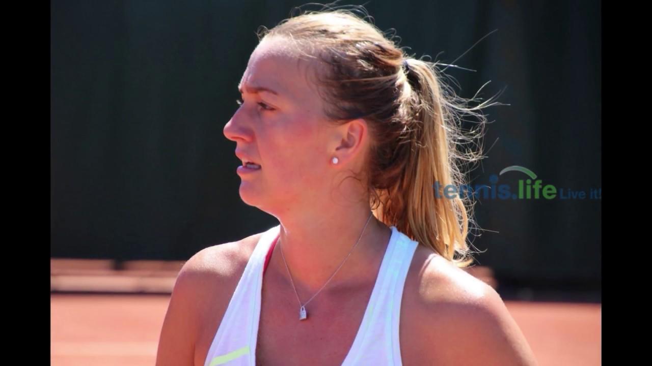 Back on court after knife attack, Kvitova wins in Paris